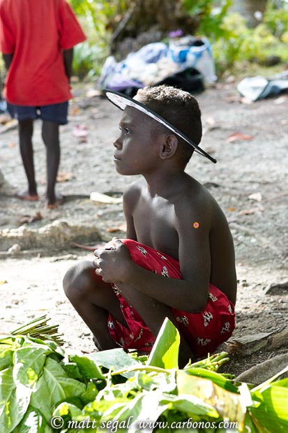 Image 995, A native island villager child of the Solomon Islands. Chief Luten's Village, Marovo Lagoon, New Georgia, Solomon Islands, Matt Segal, all rights reserved worldwide.  Keywords: native, island, villager, child, Solomon Islands