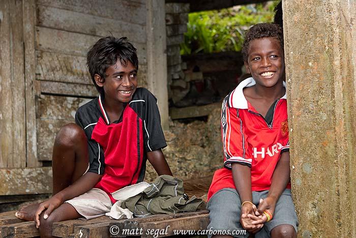 Image 1023, Local island villager children of the Solomon Islands, laughing at the Westerners. Telina Village, Marovo Lagoon, New Georgia, Solomon Islands, Matt Segal, all rights reserved worldwide.  Keywords: Local, island, villager, children, Solomon Islands, laughing, Westerners