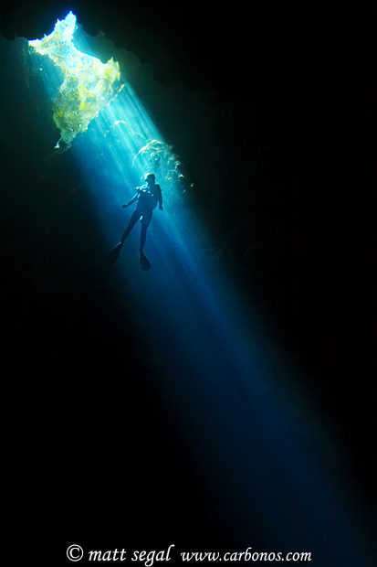 Image 1009, Diver and light beam in an underwater cave. Custom Cave, Russell Islands, Solomon Islands, Matt Segal, all rights reserved worldwide.  Keywords: Diver, light, beam, underwater, cave